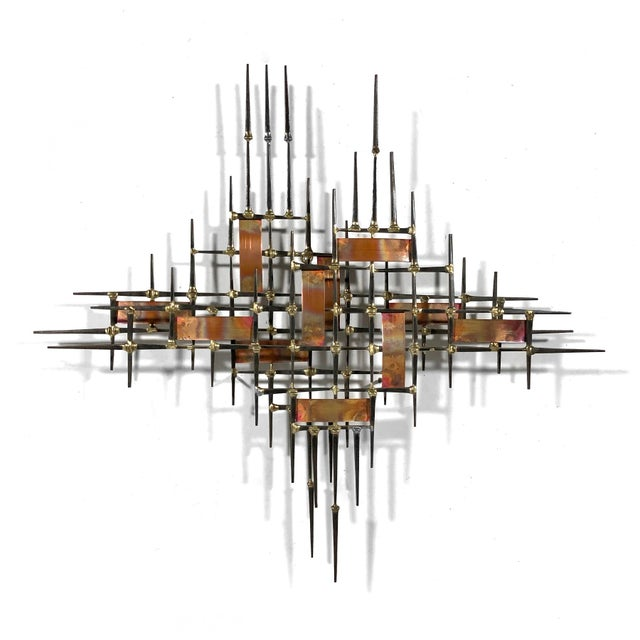 This terrific sculpture has a wonderfull linear composition created with iron brick nails welded with bronze and a...