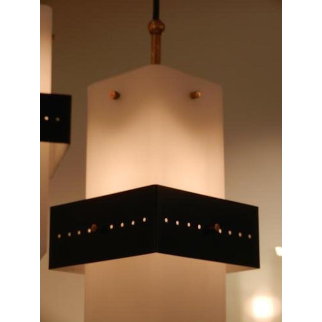 Mid-Century mobile shape chandelier featuring a brass tube abstract shaped frame from which hang three long rectangular...
