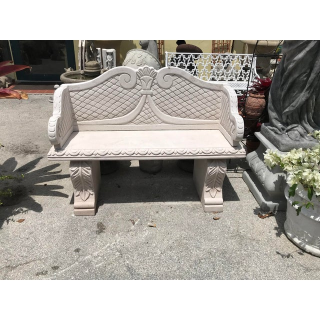 sand cast stone garden bench with a back....from the Royal Garden Works in a Marrakech, Morocco, where garden appointments...