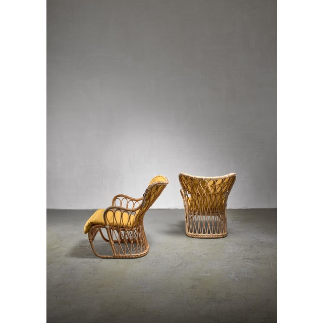 A rare pair of bamboo and wicker chairs by the designer couple Tove & Edvard Kindt-Larsen for Wengler. The chairs have...