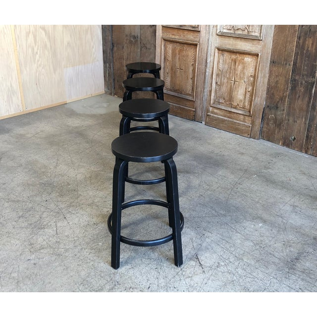 Iconic black barstool designed by Alvar Aalto and Manufactured by ARTEK furniture. These stools are in good used condition...