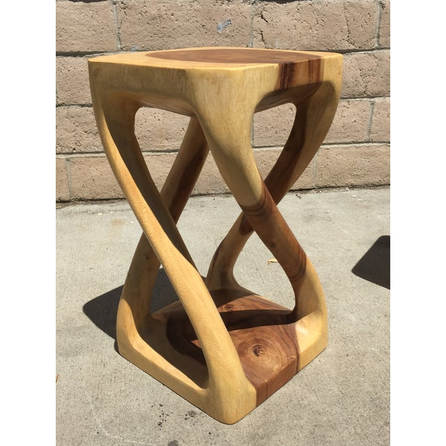 Made with acacia wood and possessing striking contrasting wood tones, the natural wood twist stool is skillfully carved...