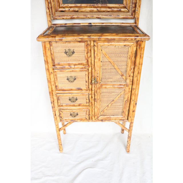 An English Victorian bamboo vanity cabiner dating from the middle of the 19th century. It is a very pleasing and usual...