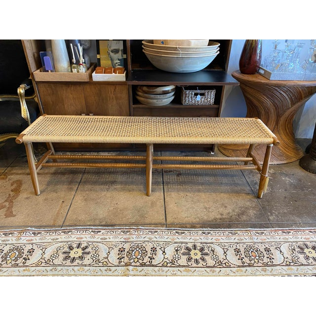 Inspired by the masterpieces of Scandinavian design, handcrafted in teak and artfully loomed fiber, this bench is...