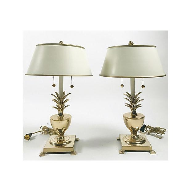 """Classic pair of Hollywood Regency-style brass pineapple lamps with original metal shades in ivory and gold. Shades, 13""""Dia..."""