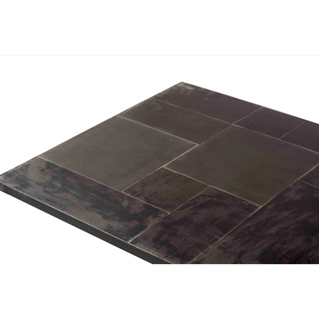 Beautiful modern coffee table with powder coated black iron base and lava stone tile inset top. Great for use indoors or...