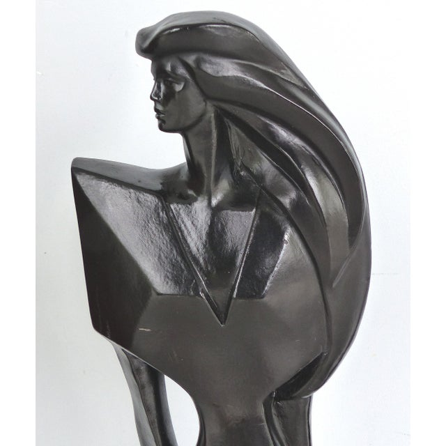 Offered for sale is a stylized plaster Art Deco-style female statue that is signed and dated 1988 on the base of the...