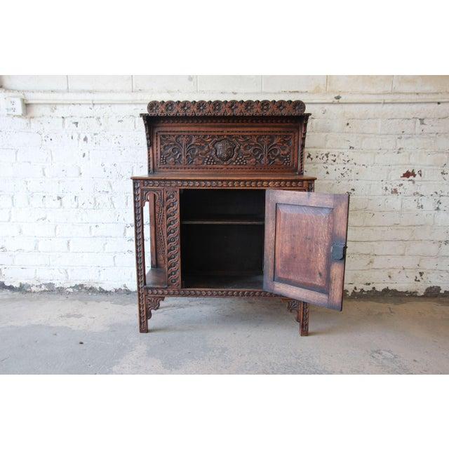 Distinguished 19th Century English Ornate Carved Oak Sideboard Bar