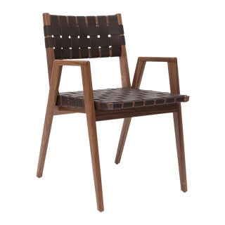 Solid woven leather and walnut dining chair with arms by Mel Smilow For Sale