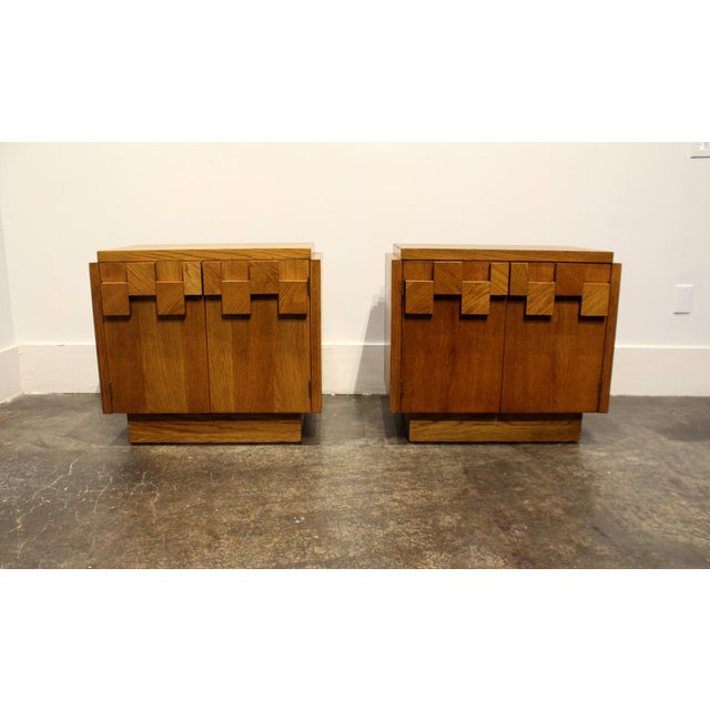 1970's Lane nightstands in beautiful golden oak. Heavy wood mosaic on front doors. Shelving on inside.