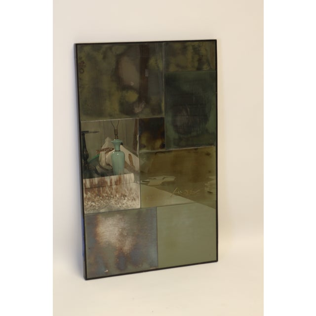 Rectangular modern wall mirror. Mirror is composed of different pieces of mirror with varying levels of distress and...