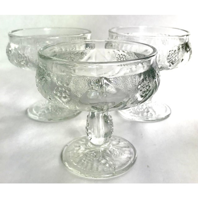 Exceptional pressed glass in a grape and leaf pattern. This set is full of pattern and interest at every angle. A...