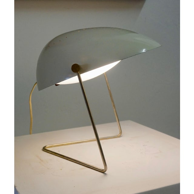 Lamp designed by Gerald Thurston for Lightolier in the 1950s. The olive green shade tilts and the lamps can also be hung...