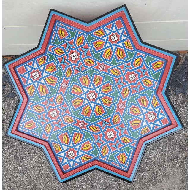 Rare find! Carved and 100% hand painted Moroccan star shape table. Large size. Made from sturdy red wood, this amazing...