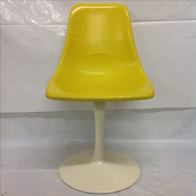 Induce a style bloom with this Saarinen-style, yellow fiberglass tulip chair! A note from the seller: We ALWAYS accept...