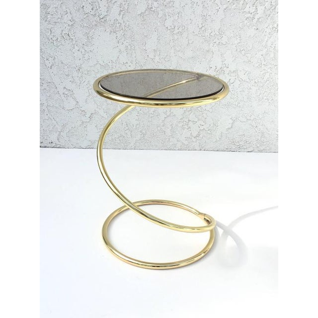 A pair of glamorous 1970s polish brass and bronze color glass tops by Leon Rosen for Pace Collection. New glass tops.