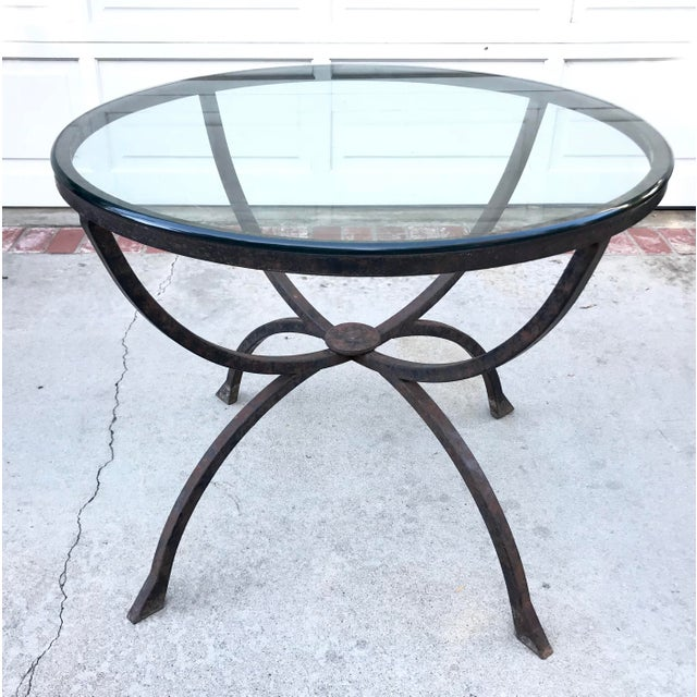 This is a gorgeous table! The base is made of iron that has been patinated to give it a masculine, industrial look. Paired...