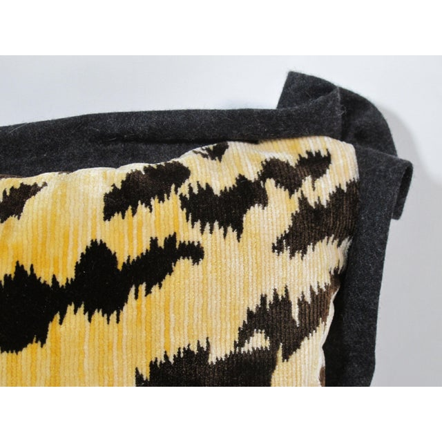 A pillow made from a sumptuous silk blend velvet , backed and edged with a charcoal wool cashmere. Mary Jane McCarty...