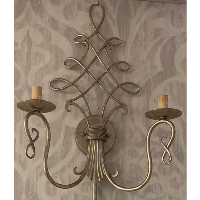 This two light Wall Sconce from the Regiment collection by Currey & Company will enhance your home with a perfect mix of...