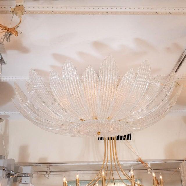 Monumental textured glass foliate form chandelier.