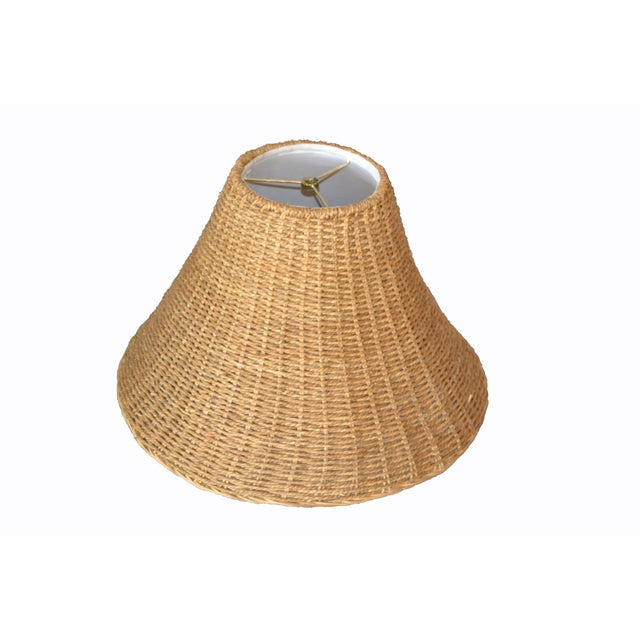 Mid-Century Modern round hand-woven Rattan, Wicker Bell or Empire Lampshade. The lampshade is lined with a white fabric.