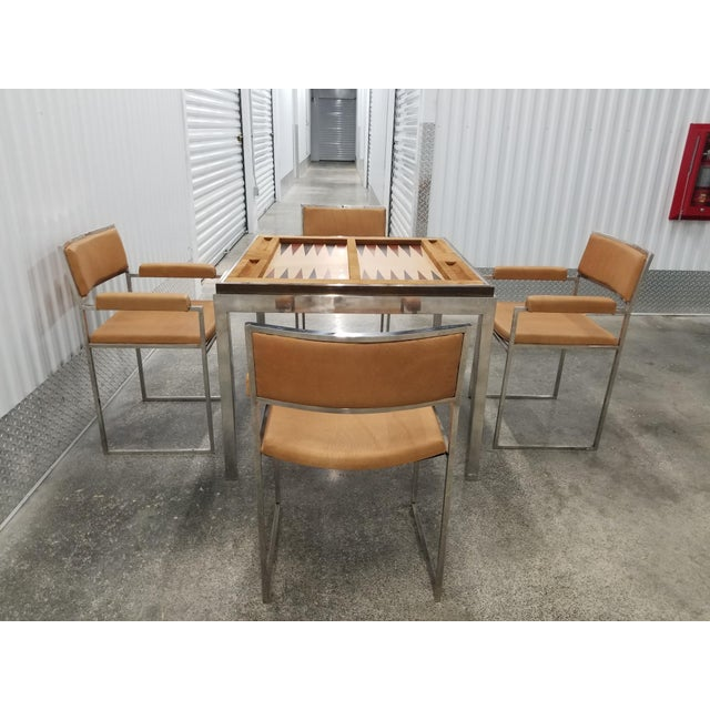 Signed Willy Rizzo gaming table and 4 chairs covered in pigskin sold as found in vintage condition previously owned and...