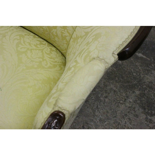 """Wood wrapped French sofa upholstered in a yellow damask. Dimensions: 77"""" x 32"""" x 37"""". seat height 16""""."""