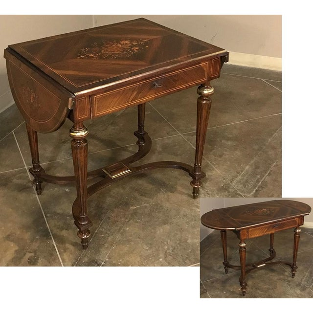 19th Century French Napoleon III Marquetry Rosewood Dropleaf Writing Table represents the combination of form, function,...