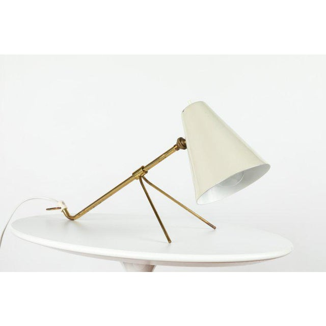 1950s Mauri Almari 'EV-73' wall or table lamp for Itsu. A rare and versatile table lamp executed in brass and white...