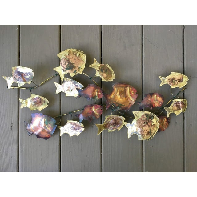 A vintage brutalist style metal wall art made of copper and brass. 16 swimming fish. Shape is adjustable- in the style of...