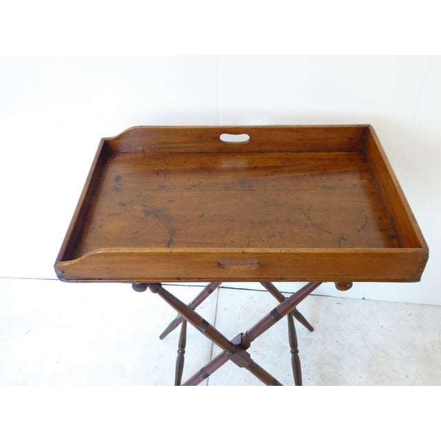 Campaign style 19th century patinated mahogany butlers tray on folding stand, sturdy.