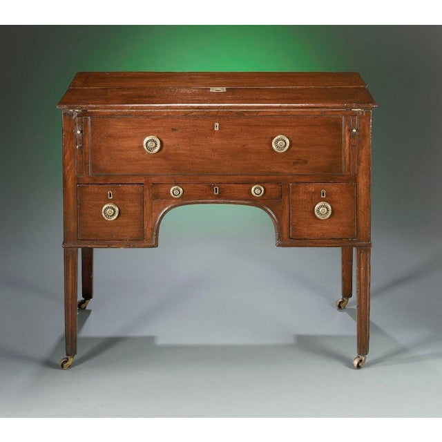 This outstanding George III mahogany mechanical desk is equipped with a leather writing surface and fully-fitted suite of...