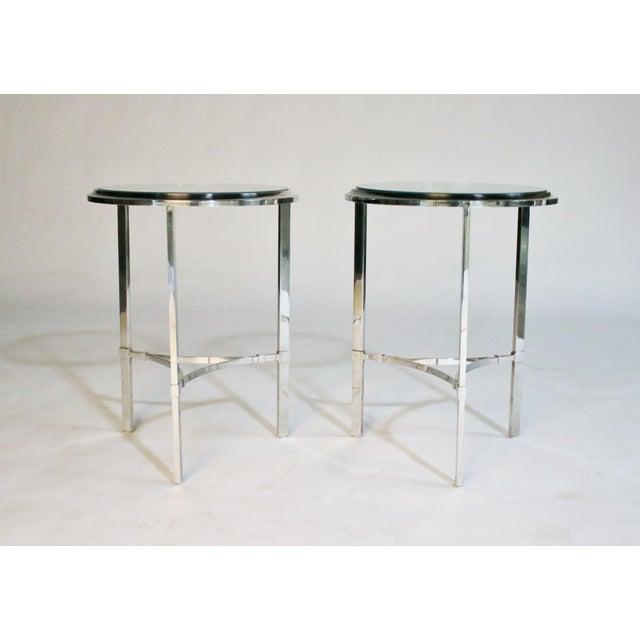 Pair of three-legged round side tables in the style of Maison Jansen. These tables probably date to late 1970's made of...
