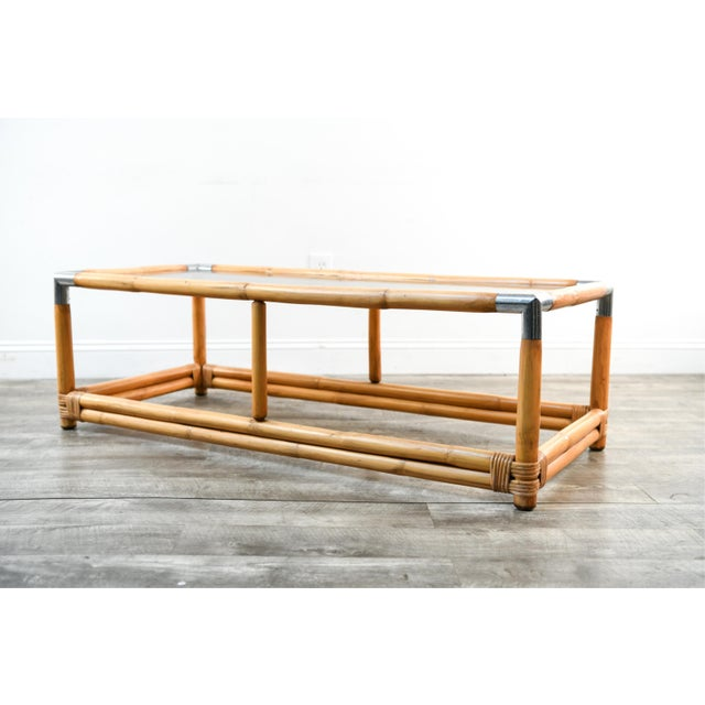 Beautiful and rare bamboo coffee table in the style of Gabriella Crespi. Made in Italy circa 1960s. Glass top, brass...