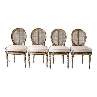 Early 20th Century Carved and Painted Louis XVI Style Cane Back Dining Chairs - Set of 4 For Sale