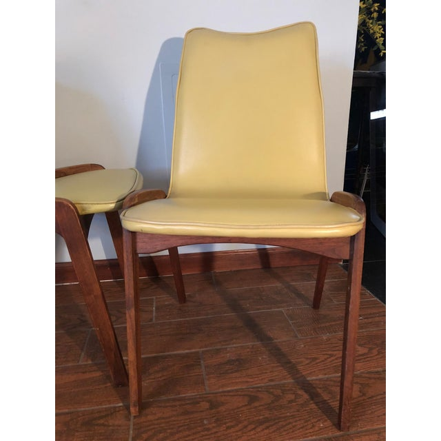 Mid Century Modern pair of Johannes Andersen by Richbilt teak chairs. The tag on bottom say made by Richbilt. They are...