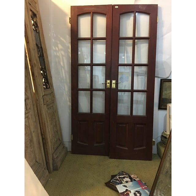 A nice pair of not very old English Doors with glass panes and brass hardware. A great design. A wonderful decorative...