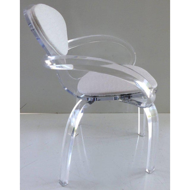 Offered is a custom-made bent Lucite pretzel chair paying homage to the Norman Cherner original of bentwood. This chair is...