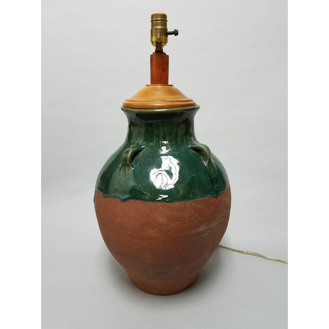 An antique olive jar custom wired lamp. The terracotta vase features a lovely green drip glaze with a slight crackle. The...