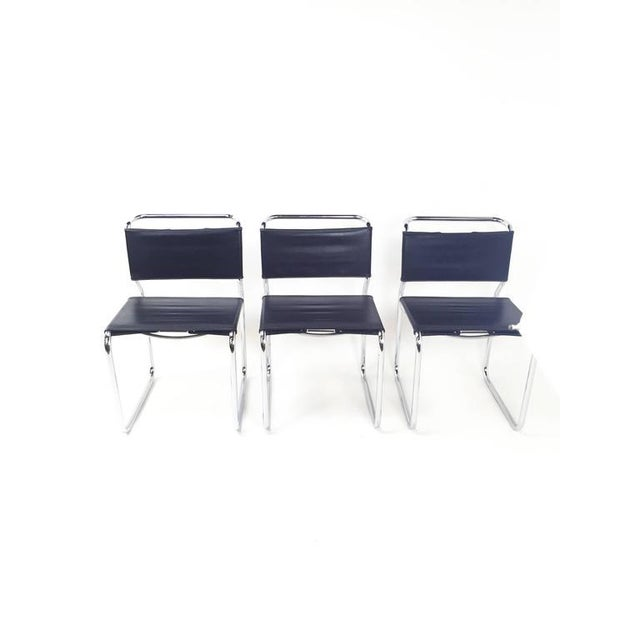 Early version by GF (General Fireproofing) Nicos Zographos 66 chairs in black vinyl with white stitch. Patina to steel...