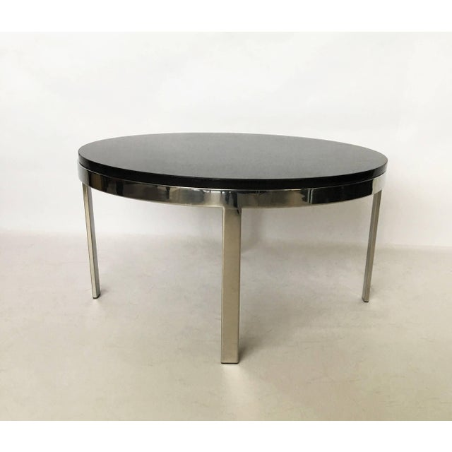 Polished flat bar chrome frame with an inset granite top coffee table in the style of Milo Baughman.