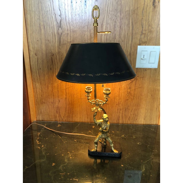 "Vintage Gilt Brass and Tole Bouillote Monkey Motif Table Lamp. Two lights and an adjustable shade that rises and lowers 2""..."
