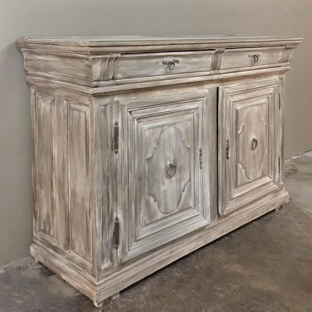 Early 18th Century Country French Whitewashed Buffet represents the essence of understated elegance, with fine molded...