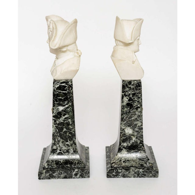 PLEASE ADD DIMENSIONS The alabaster busts, over a serpentine marble base with bronze dore mounts