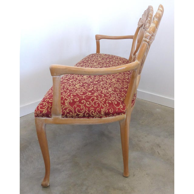Offered for sale is a carved wood settee created in the style of LaVerne. The settee has a graceful curved form with Art...