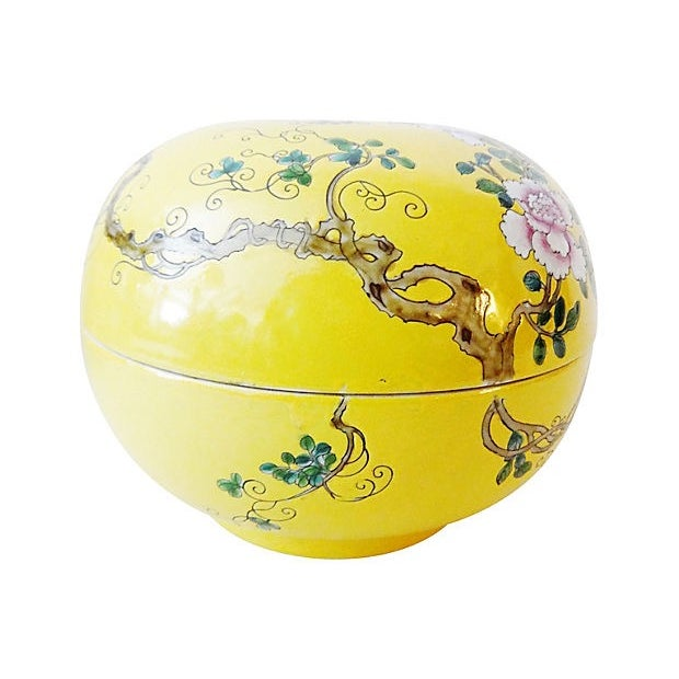 Large Famille Jaune porcelain lidded box decorated with peonies and a bird against a yellow background, with a maker's...