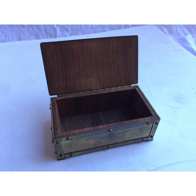 Vintage brass box. D and Z insignia on top. Wood lined interior. Well rubbed patina finish with lots of character.