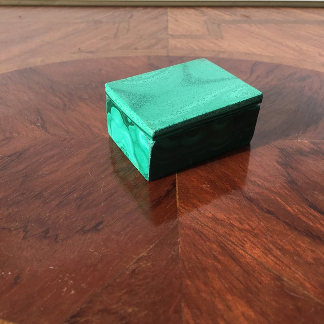 A charming malachite trinket box with a removable lid.