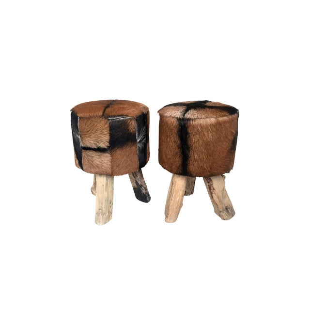 Late 1970's pair of stools of African origin. Raw wood tripod base. Priced for the pair.