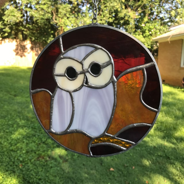 Beautiful stained glass owl with chain for easy hanging. Beautiful hanging inside or outside. Looks great when the light...